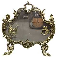 Done in the Louis XV Rococo style, this antique gilt bronze fire screen dates to the century. The gilt bronze frame is done in a cartouche form with C scrolls and foliage, as well as putti with arrows. Rococo Style, Decorative Objects, Decorating Your Home, Bronze, Fire, Antiques, Interior, Antiquities, Antique