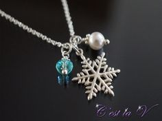Winter Glow sterling silver necklace. Includes a snowflake pendant, a Swarovski crystal, Swarovski pearl, and sterling silver chain.    $69     Etsy Store: https://www.etsy.com/ca/shop/cestlavjewelry?ref=hdr_shop_menu