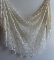 """Wedding Belle was inspired by a request from my friend. Her daughter wanted a """"vintage"""" silver shawl with lots of beads for her son's wedding. When I think of """"vintage"""" my mind goes automatically to the Haapsalu stitch patterns."""