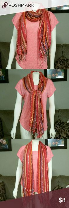 "Autumn Scarf - multi-tone ** This beautiful multi-tone scarf is perfect for fall! Colors of pink, red, burnt sienna, orange and earthy blue plus shiny silver tinsel thread makes this an autumn must-have! Dimensions: 70""x25"".   **Please note damage: Both ends have a 2""x2"" square torn from the ends (washing machine mishap?) As shown in picture 4. This is not noticeable when wearing due to the intricate detailing and thread-fringe finish. Also a few minor pulls in fabric,  not very noticeable…"