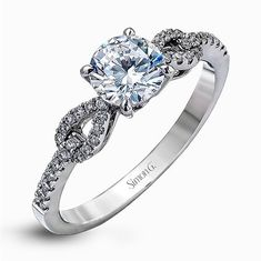 Accented by charming teardrop side designs, this lovely white gold engagement ring and band is accentuated by .28 ctw of round white diamonds for an unforgettable contemporary setting. Print Page