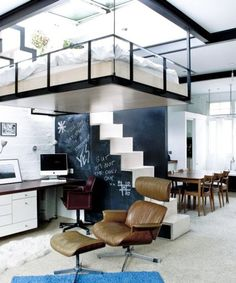 A loft bed is a great way to maximize floor space, and the one you'll find in this bohemian studio apartment in Camden, London will probably make you green with envy. It sits under a retractable skylight that leads to a 500-square-foot rooftop...