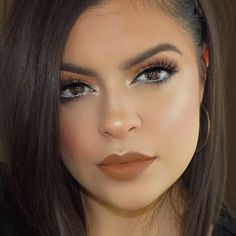 Recreate this stunning formal look featuring warm neutrals and a hint of shimmer. Refer to this how-to and the makeup essentials listed to begin.