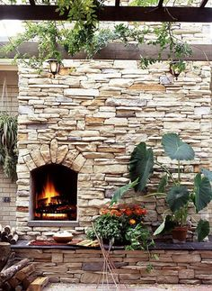 Limestone outdoor fireplace. #laylagrayce #landscapedesign