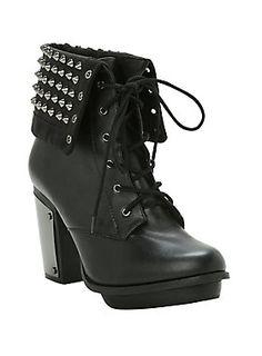 """<p>Black faux leather lace-up combat boot with hematite tone studded flap and metallic heel plate. True to size.</p>  <ul> <li>4"""" heel, 1"""" platform</li> <li>Man-made materials</li> <li>Imported</li> </ul>"""