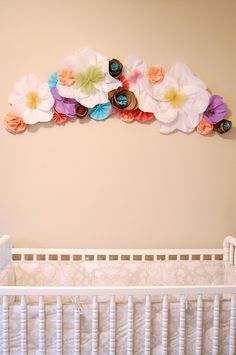 Paper flower wall art looks gorgeous in a nursery and certainly adds girl flower power to a Tweens room too