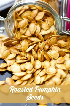 Roasted Pumpkin Seeds - don't know what to do with the seeds after you carve that pumpkin? Create a a healthy crunchy snack with the seeds. Easy and delish!