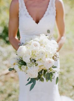 The bridal bouquet wil be a clutch of cream hydrangeas, ivory garden roses, blush spray roses, jasmine vine, grey dusty miller, fresh lavender, and jasmine vine wrapped in ivory ribbon with the stems showing.