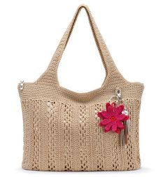 Casual yet chic, the Large Tote in Bamboo with Gold is beautifully hand-crocheted with a soft tan and shimmering gold that will make them look twice. Whether you're headed to the pool, running errands around town, or off to lunch with friends, this textured tote will pair with any outfit. Comes with removable charm keychain for a pop of color.