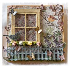 Spring scene. Sizzix window die and iron fence die with lots of stencilling.