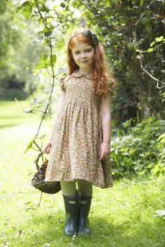 Our 'Iris' dress in Autumn Posy - A serene simple dress with fine delicate smocking, a Peter Pan collar, little puff sleeves and a sash to tie at the back. Handmade in our colourful Autumn Posy, cotton needle cord. Precious Children, Beautiful Children, We Are The World, Fall Dresses, Belle Photo, Cute Kids, Red Hair, Redheads, Little Girls