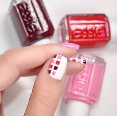 Square things off with this nail design. Recreate this patterned essie nail art using a white shade like 'blanc' as a base shade. Next, create a square pattern on your ring finger, middle finger and thumb alternating between pink and red shades like 'lovie dovie', 'sole mate' and 'really red'. Finish off the look by painting your pinkie and index finger a solid 'lovie dovie'.