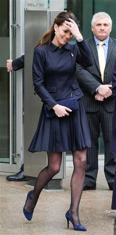 Duchess Kate does it again! The poised mom worked an all-navy ensemble at Place2Be charity in on Nov. 20, 2013. The fitted top paired with an airy, pleated skirt was a playful yet graceful choice.