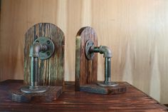 Industrial Book Ends, Steampunk Book Ends, Game Holders, CD Holder, Pine Wood Book Ends, Pipe Book Ends by cmhomedecor1 on Etsy https://www.etsy.com/listing/279058286/industrial-book-ends-steampunk-book-ends
