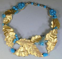 Coppola e Toppo Necklace Paper, tin and gilt-metal leaves loosely designed with turquoise beads and pale blue beads.  Sold for $550