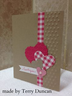 handmade Valentine card .. kraft base with reid and white ... country charm ... gingham ribbon/wasshi line die cut montage of hears ... great card!!