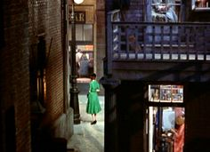 Rear Window. Miss Lonelyhearts on her way to the neighborhood bar for a pick-me-up and maybe romance.