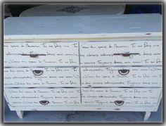 cream dresser with brown script writing