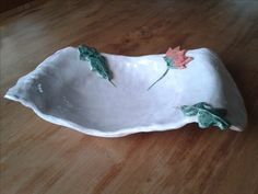 ceramic plate with flower and leaves