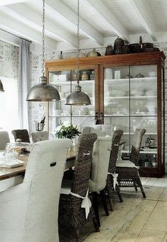 Love the white dishes against distressed wood, plus the beams and ceiling painted white. great feel to the room.