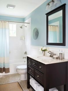 white shower tile, wainscoating, wall color, dark wood is pretty.