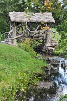 "X McCourtie Park Somerset Center, MI.  Beautiful ""wooden"" bridges & chimneys made of cement, elaborate birdhouses, and underground rathskeller & tunnels from the bootlegging days"