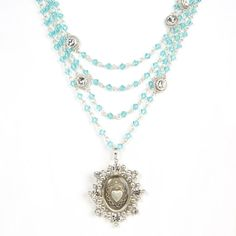 The Magdalena has been a VSA Classic as it is most versatile in style Wear open and long or layered The turquoise beads are reminiscent of sandy white beaches & Carribean oceans -Plated Bronze -Medallion is covered with a resin finish & is detachable - Length 12.5-14.5 inches plus medallion -Toggle Closure - Faceted Bicone crystals beads that add a POP of color -Handmade in San Miguel Allende Turquoise Water, Turquoise Beads, Crystal Beads, Crystals, White Sand Beach, Sacred Heart, Beaches, Color Pop, Plating