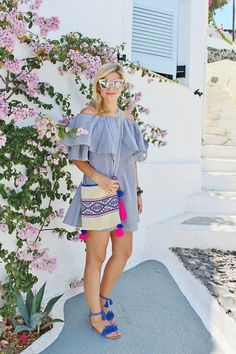 bijuleni: The perfect Outfit for a Greek Island. Shoulder Ruffle Dress, Strappy fringe sandals, crossbody messenger bag and Quay Sugar And Spice sunglasses
