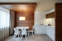 Ariston Dolomiti Residence by Bergundtal ... absolutely love the wood wall transition into the ceiling.