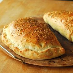Calzones Recipe. Basically -- make pizza dough, roll it out, stuff, and fold over.