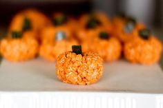 Halloween Rice Krispies pumpkins dyed orange with black licorice as the stem.