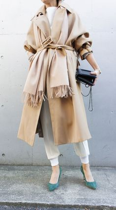 Keep it warm and cozy for Fall by layering a scarf with your favorite trench.