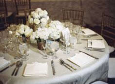 all white centerpieces | Photography by braedonphotography.com |  Event Planning by xoxobride.com |  Floral Design by moderndaydesign.com |   Read more - http://www.stylemepretty.com/2013/06/28/santa-barbara-wedding-from-xoxo-bride-braedon-flynn-photography/