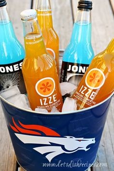 Orange and Blue Broncos Themed Superbowl Party Menu - I love the clementine flavored Izzies!  Plus it's originally a Boulder company!