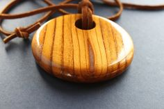 Turned Russian Olive round circle pendant necklace, by on etsy. Circle Pendant Necklace, Wood Necklace, Wood Earrings, Pendant Jewelry, Wooden Jewelry, Unique Jewelry, Woodturning, Jewelery, Trees