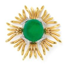 Verdura Clip, Circa 1940's... 18kt gold, platinum, set with diamonds and a monster center stone, at 107 cts this emerald cabochon is magnificent.