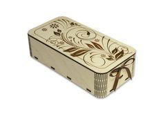 Упаковка для подарков прямоугольной формы с закругленными углами выполнена из фанеры с применением лазерной резки и гравировки. На крышке изделия изображен рисунок в виде вензелей стилизованных под цветы. Коробка украшена узкой лентой коричневого цвета, которая соединяет боковой стык и завязывается на бантик. Размер подарочной коробки 20*5,5*10,5 см. #Канышевы #Подарочнаяупаковка #упаковкадляподарков #Эксклюзивнаяупаковка #упаковкадлякорпоратиногоподарка #корпоративныйподарок…