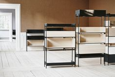 A flexible shelving system that embodies Scandinavian simplicity. The Vivlio shelving system consists of two elements: a frame made of painted steel and shelves made of natural ash or stained black ash wood. The shelves come in three different heights, and may either present their open front to the room or face away to conceal …