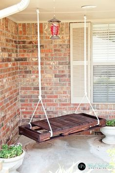 Easy to make porch swing. Cut a pallet in half, stain it, hang with rope. by tommie