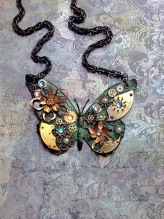 Steampunk Butterfly Necklace - Custom Design Green Patina Butterfly with Watch Gears Brass Flowers and Jewels. $110,00, via Etsy.