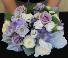 The bridesmaids bouquets were an elegant mix of roses, garden roses, lisianthus, scabiosa, lavender and dusty miller.