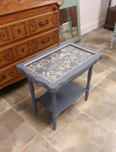 Early 1900s tea table with removable serving. An old, traditional design reimagined for today's home.