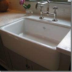 Like the faucet, cabinet latch and subway tiles but not sure about the sink being undermount.