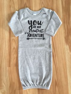 """We are now offering these adorable """"slogan""""designs on baby gowns! These gowns are so soft and cuddly and perfect for newborn babies up to 6 months. They make diaper changing easy and help keep baby all snuggly and warm, especially during these winter months. Time to stock up on baby shower gifts! Such a perfect present for a soon-to-be momma, parents that are adopting, little miracle babies, or just because. We tried to make the designs and colors unisex, so they will work perfec..."""