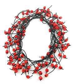 "Marge Levy: Necklace in letter beads and black elastic. Approx 70-80"" long. May be worn doubled or tripled."