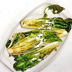 Have you tried grilled LETTUCE? Smokey, crispy, naturally sweet, make this Romaine With Lemon-Pepper Yogurt Dressing tonight | health.com