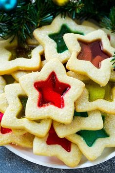 These beautiful stained glass cookies are buttery sugar cookies with a candy center. A holiday classic that tastes as good as it looks! Buttery Sugar Cookies, Chewy Peanut Butter Cookies, Spritz Cookies, Sugar Cookies Recipe, Yummy Cookies, Holiday Cookies, Cookie Recipes, Dessert Recipes, Making Cookies