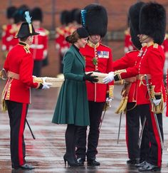 Catherine, Duchess of Cambridge (aka Kate Middleton) hands out shamrocks to the Irish Guards at Mons Barracks during the St Patrick's Day military parade in Aldershot on March 17, 2013