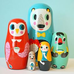 Hand-painted wooden nesting dolls featuring three bears, a friendly owl and Goldilocks.