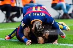 Neymar Santos Jr (top) and Lionel Messi (middle) of FC Barcelona celebrate with their teammate Luis Suarez (R) after he scored his team's second goal during the La Liga match between FC Barcelona and Club Atletico de Madrid at Camp Nou on January 30, 2016 in Barcelona, Spain.